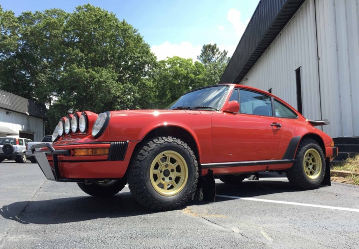side view of Custom Built 1986 Porsche 911 Carrera in Indian Red with Porsche Studiocheck Interior
