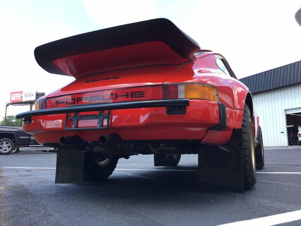 rear view of a Custom Built 1986 Porsche 911 Carrera in Indian Red with Porsche Studiocheck Interior