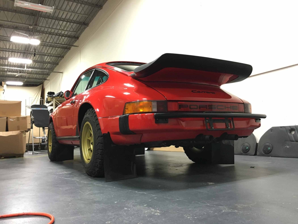 rear view of Custom Built 1986 Porsche 911 Carrera in Indian Red with Porsche Studiocheck Interior