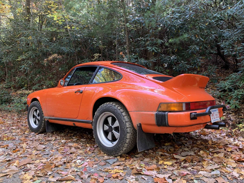 rear view of a Custom built 1987 Porsche 911 Carrera with Continental Orange exterior and VW tartan interior