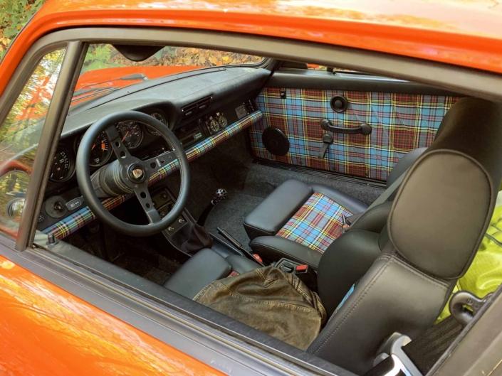 VW tartan interior on a Custom built 1987 Porsche 911 Carrera with Continental Orange exterior