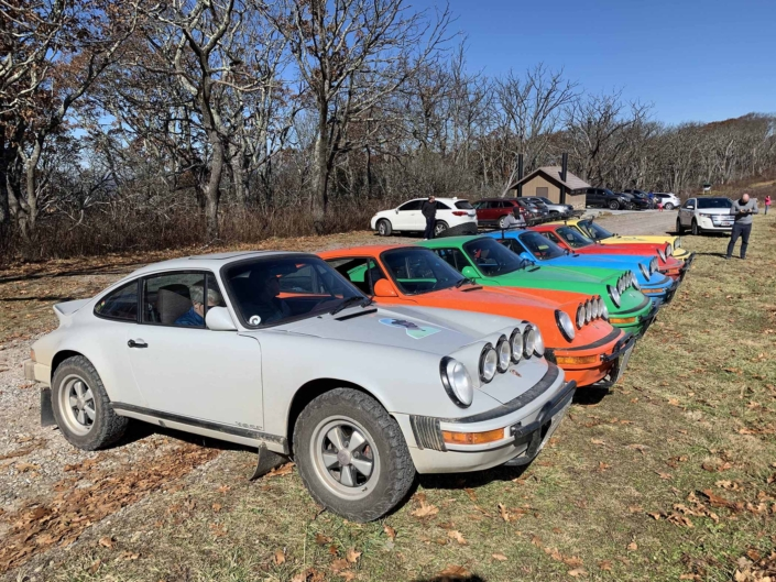 Custom Built 1986 Porsche 911 Carrera with Fashion Grey Exterior and Lancia Fabric Interior parked in a lineup of custom porsche's