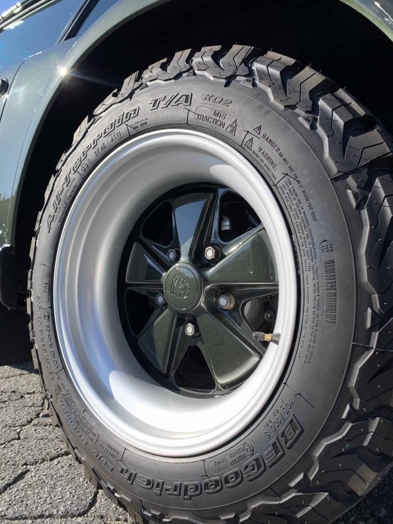 tire shot of a Custom Built 1986 Porsche 930 Turbo with Oak Green Metallic Exterior and Porsche tartan interior