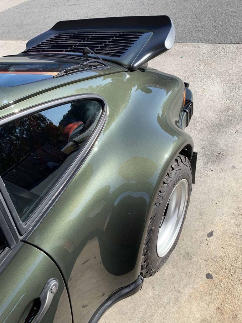 rear view window on a Custom Built 1986 Porsche 930 Turbo with Oak Green Metallic Exterior and Porsche tartan interior