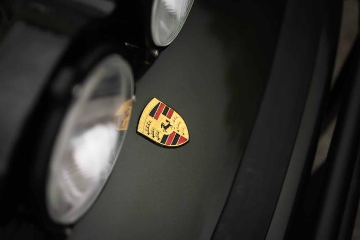 porsche emblem on a Custom Built 1986 Porsche 930 Turbo with Oak Green Metallic Exterior and Porsche tartan interior