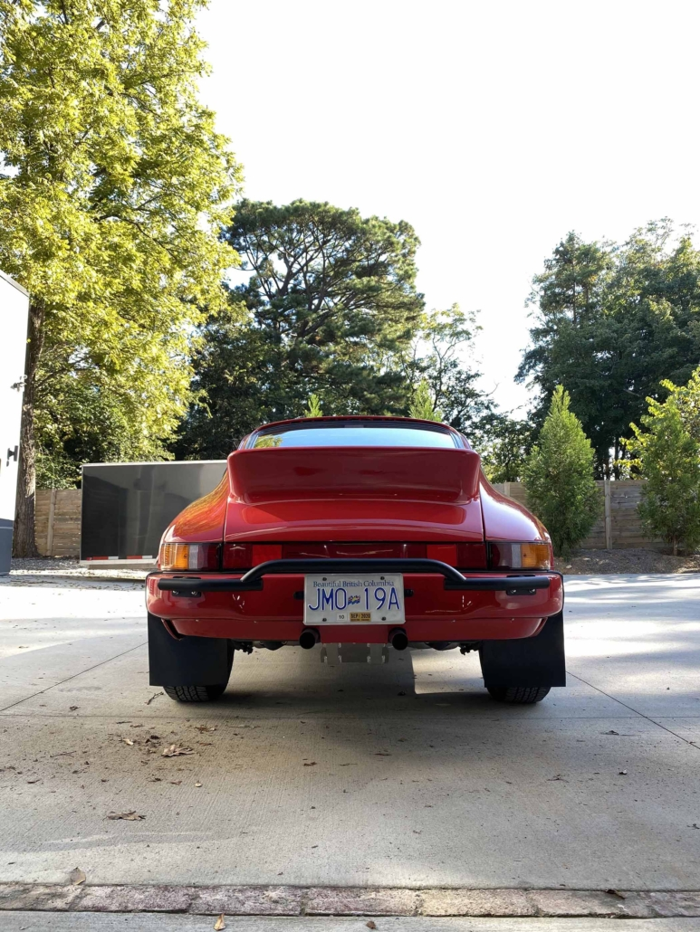 rear view of a Custom Built 1987 Porsche 911 Carrera with Cherry Red exterior and VW retro interior