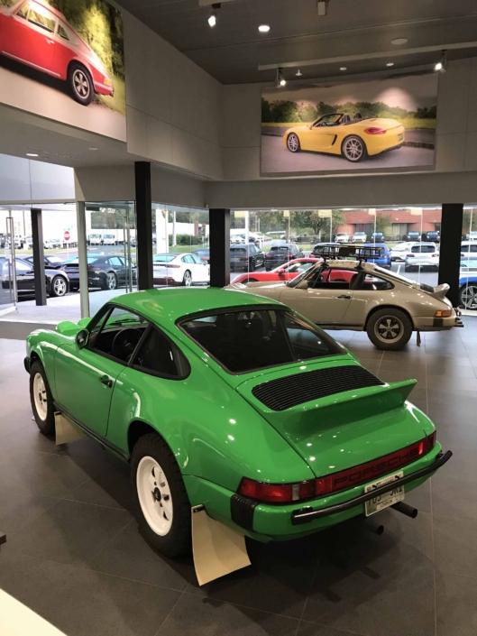 rear view of the Custom Built 1981 Porsche 911 SC in Signal Green with Porsche Tartan Interior