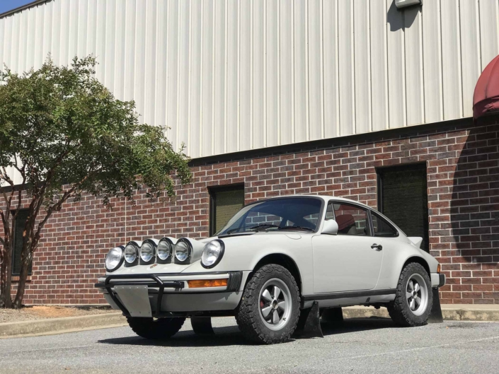 3/4 front view of Leh Keen's Custom Built 1986 Porsche 911 Carrera with Fashion Grey Exterior and Lancia Fabric Interior