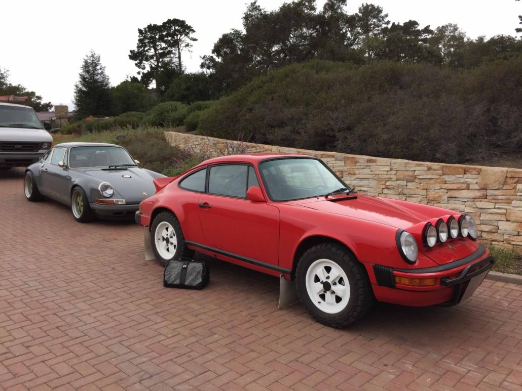 Custom Built 1981 Guards Red Porsche 911 SC parked on brick pavement