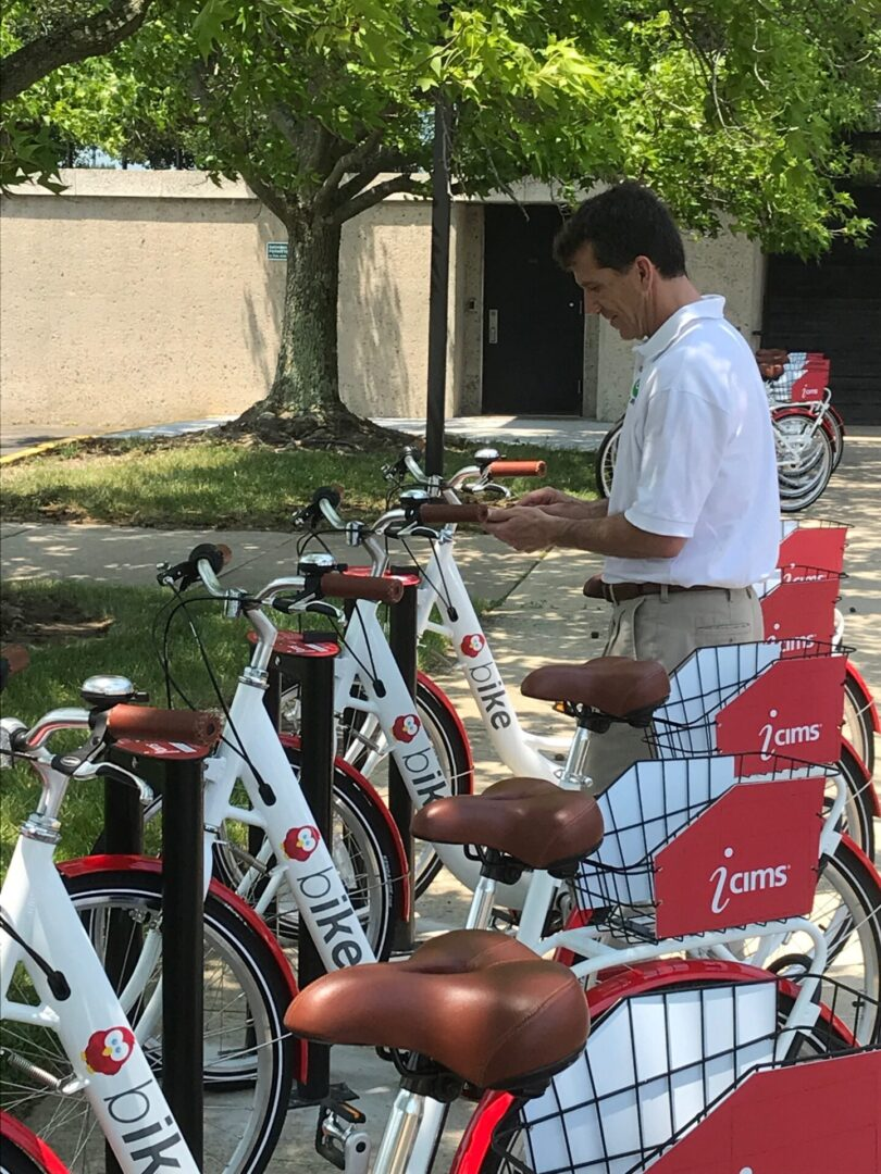 A man by a set of branded bicycles
