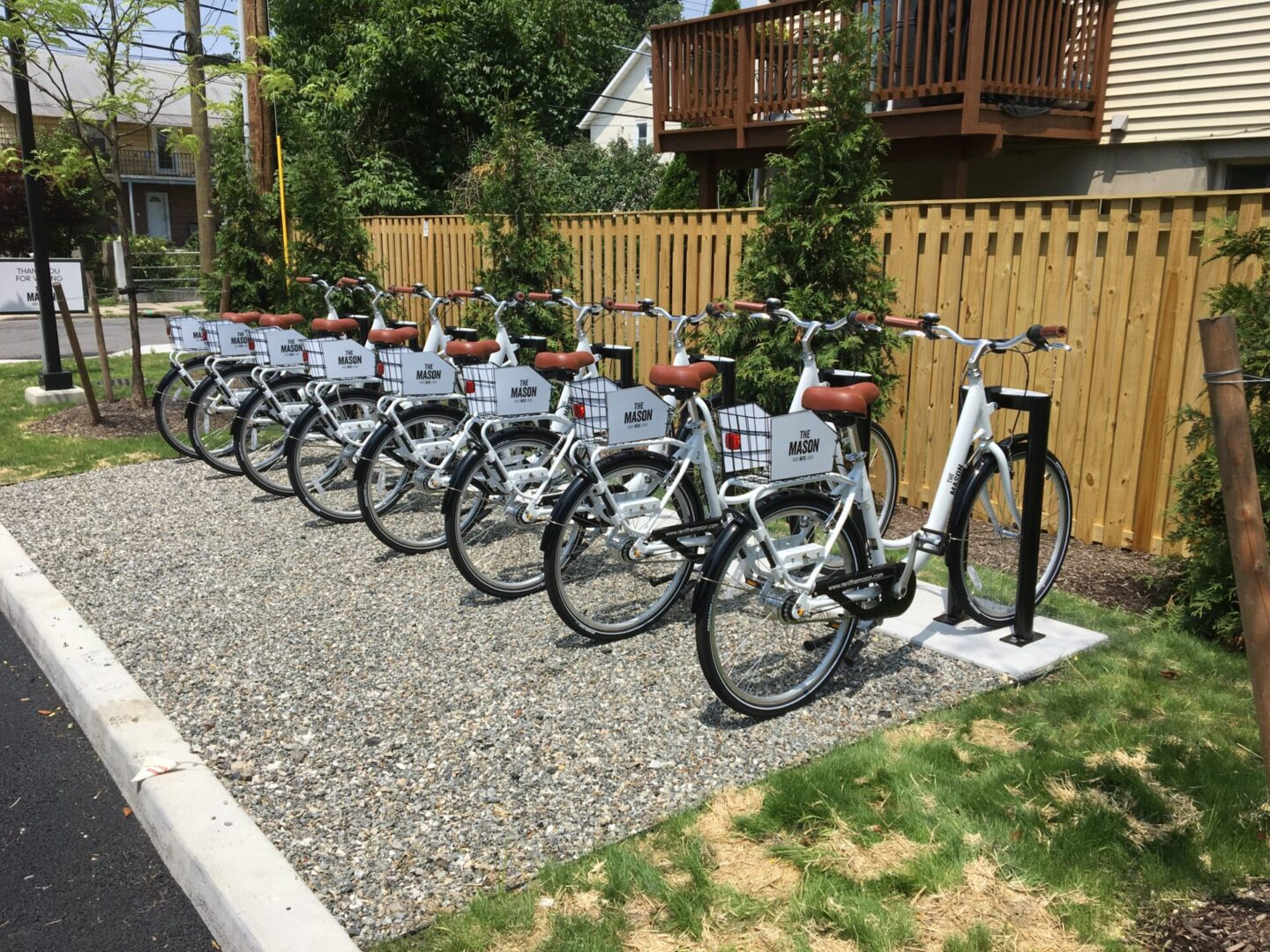 6 white bicycles lined up