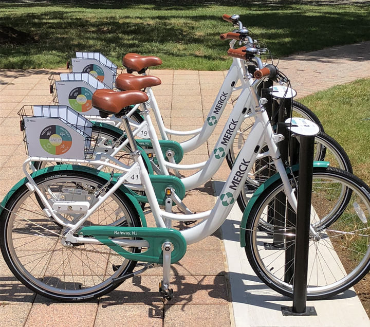 three bicycles with a Merck branding