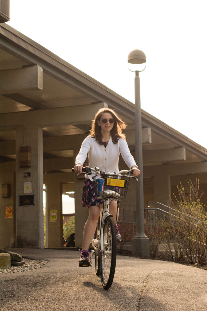 Faculty riding bicycle