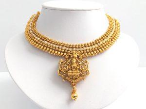 Ornate Lakshmi Pendant Attigai with Matching Jhumkas