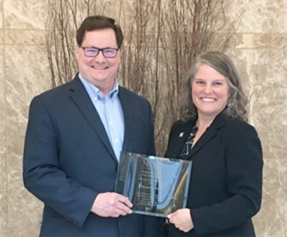Margaret Allen receives NASJE's Karen Thorson Award from President Dr. Anthony Simones at the 2019 NASJE Annual Conference