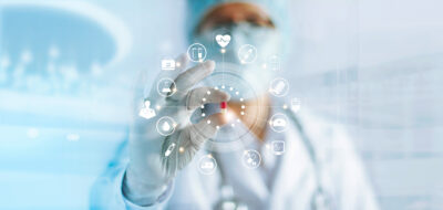 edicine doctor holding a color capsule pill in hand with icon medical network connection on modern virtual screen interface in laboratory background, medical technology network concept