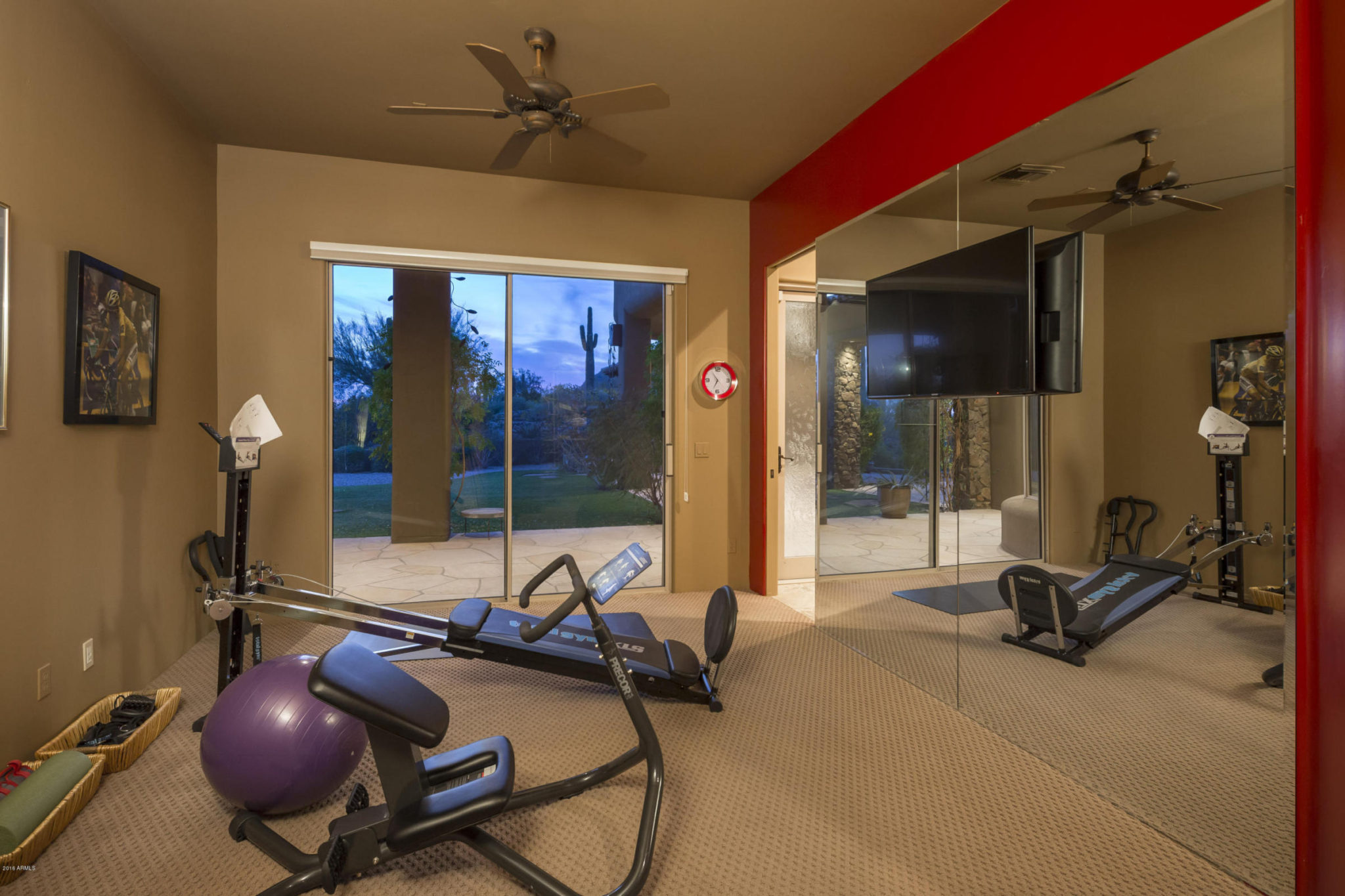 Beveled edge gym mirror with TV