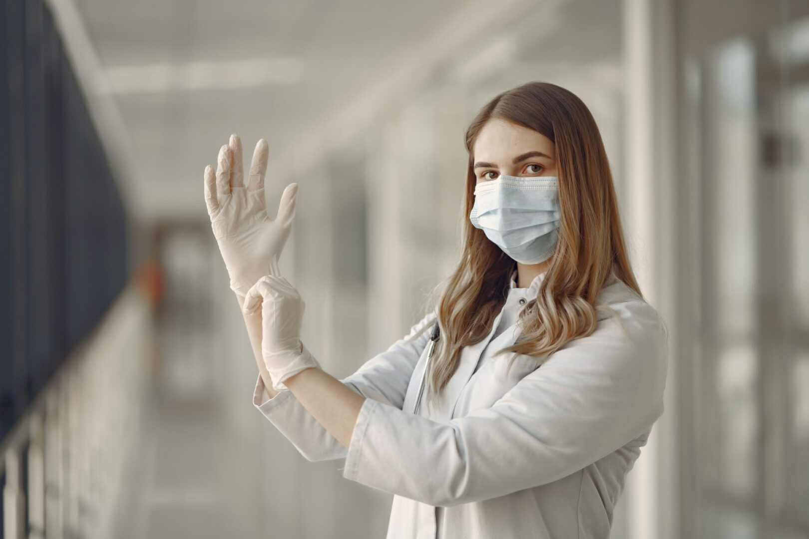 woman-in-white-long-sleeve-shirt-wearing-white-gloves-3985160