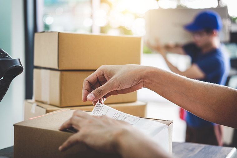 hands touching a box for shipping near me