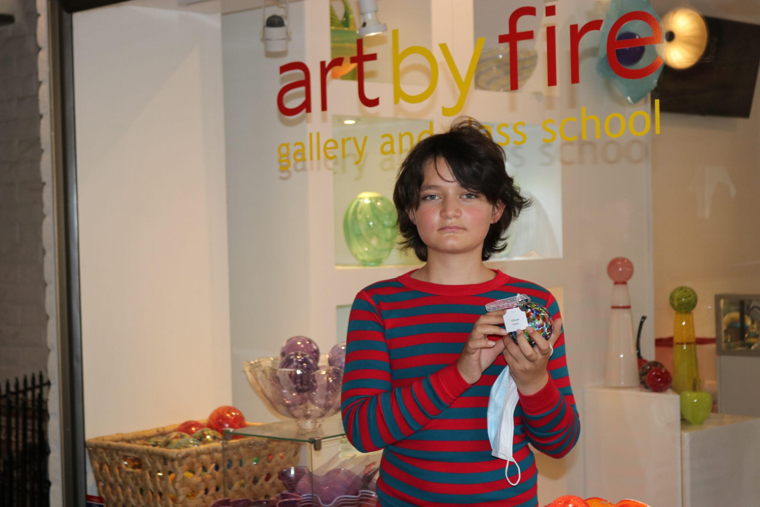Oliver holding ornament