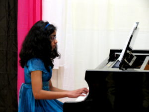 Girl Taking Piano Lessons