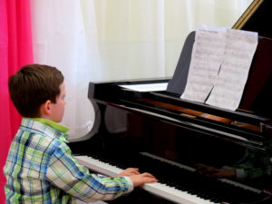 Little Boy Taking Piano Lessons home