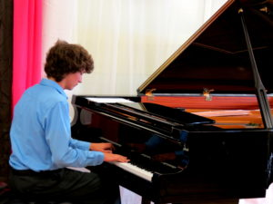 Piano Lessons Dix Hills teenage boy