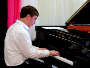 Teen Boy Taking Piano Lessons Commack
