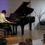 Teen Performing at Piano Lessons