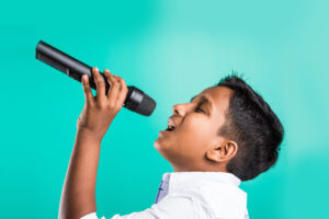 Young boy having voice lessons