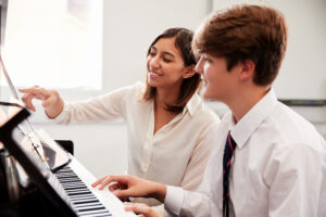 Piano Lesson with Student and Teacher
