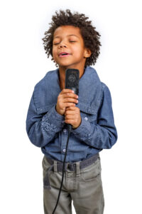 Boy learning at his voice lesson