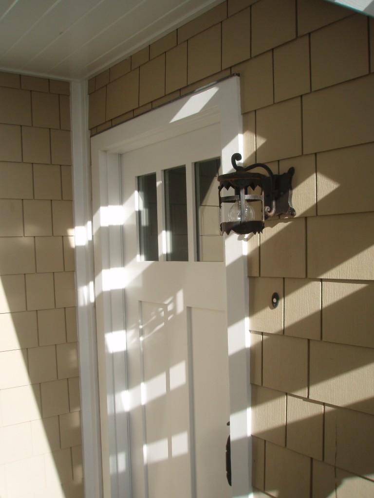 Downstairs Entry Door & Light Fixture