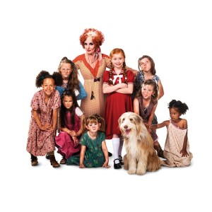 ANNIE - Lesley Joseph as Miss Hannigan with Annie and orphans. Photo credit Matt Crockett