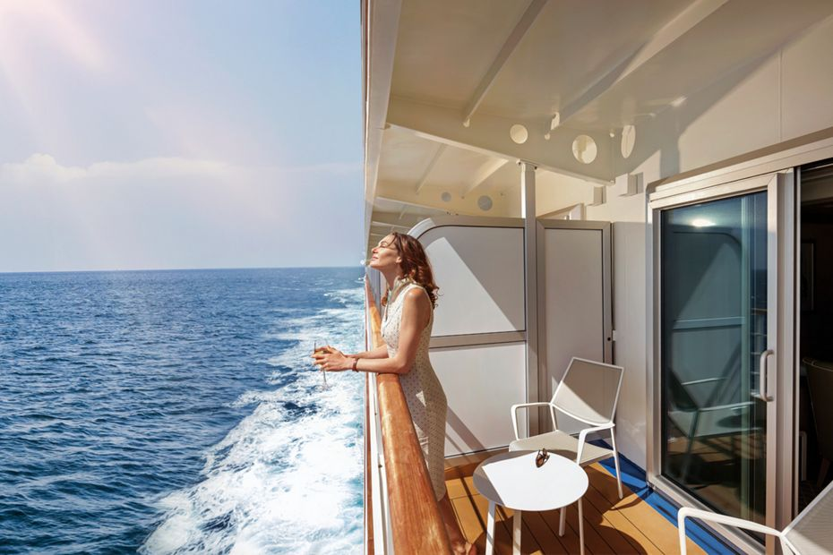 silversea-luxury-cruises-silver-muse-veranda-suite-woman-sun