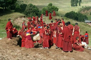 Xiahe Monks repair water supply system near Labrang Monastery