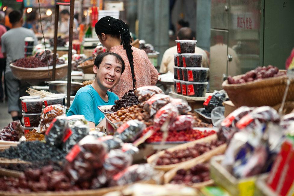 shutterstock_111908837 Shanxi, Cheerful Hui muslim at his market stall