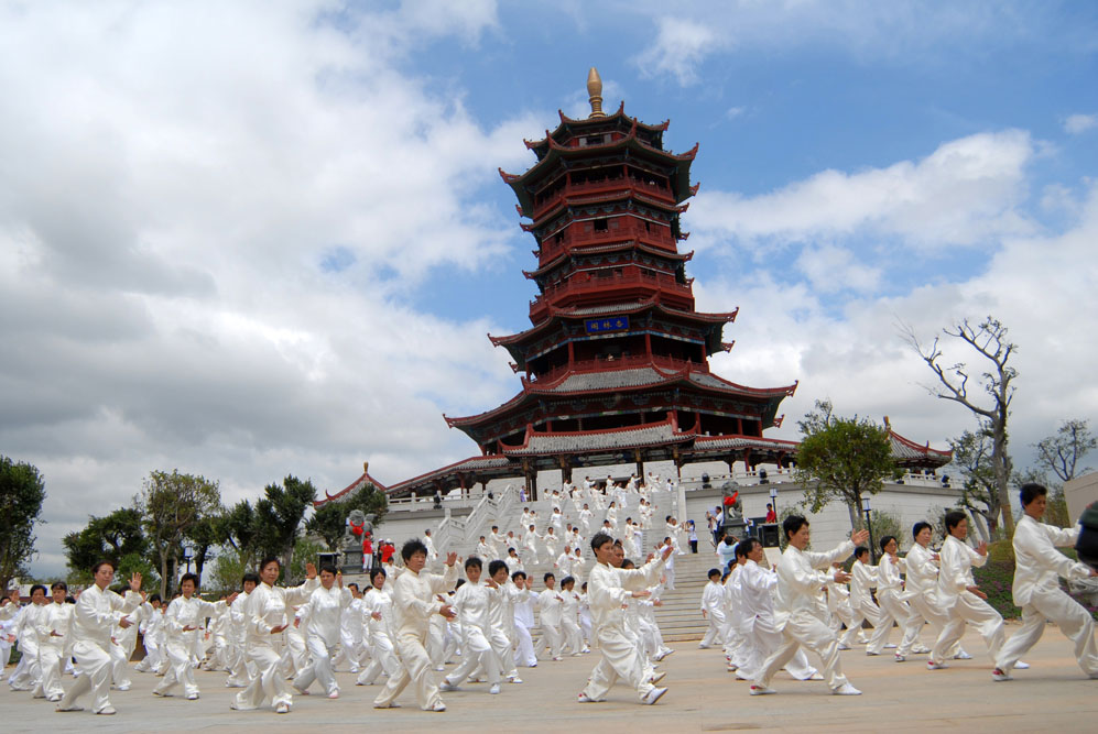 Tai Chi before traditional Chinese building, Fujian