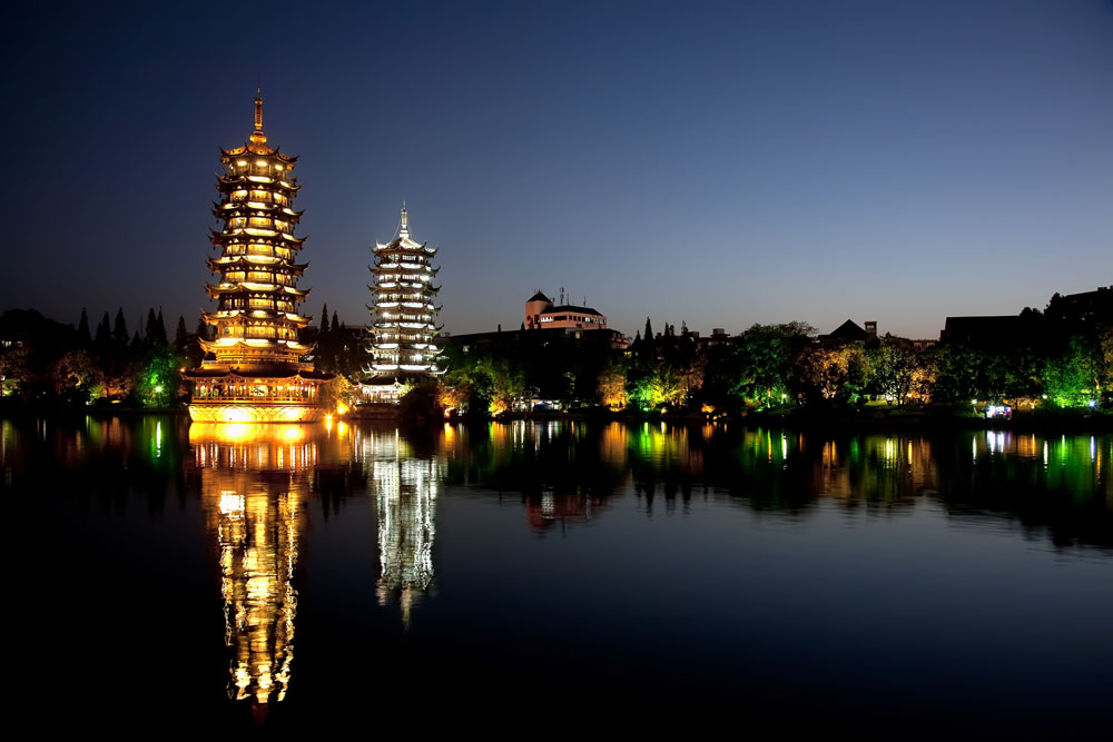 shutterstock_122283634 Guangxi, Evening view of the Gold and Silver Pagodas, also known as the Sun and Moon Pagodas, reflected in Shan Lake Guilin, Guangxi, China