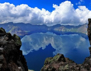 shutterstock_108745796-1 Jilin, Reflection of sky at Heaven Lake on top of Changbai Mountain or Baekdu Mountain overlooking North Korea from Jilin Province