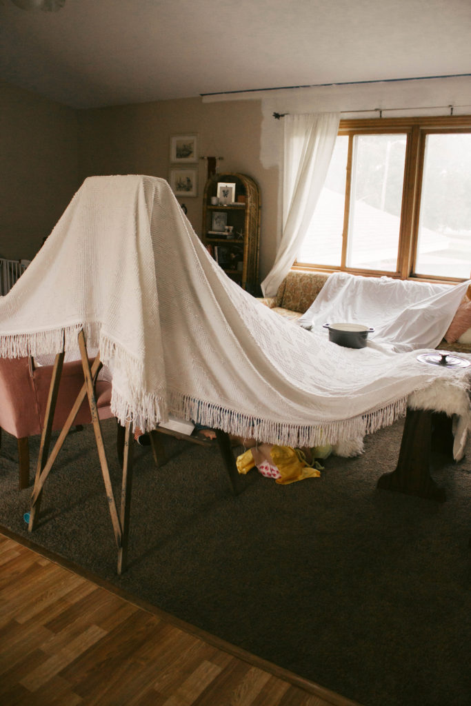 We had a cold rainy summer day so we built a fort and had a pear picnic