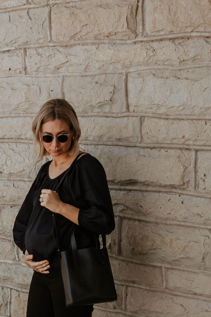 An all black outfit, outfits that transition to fall, maternity style, new in at everlane, everlane day tote mini, everlane air ruched blouse, all black summer outfit, clear framed glasses