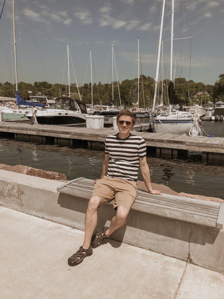 sailboats at a marina in door county, egg harbor, boats on lake michigan, everlane men's t-shirt, striped tee with khaki shorts, keen sandals