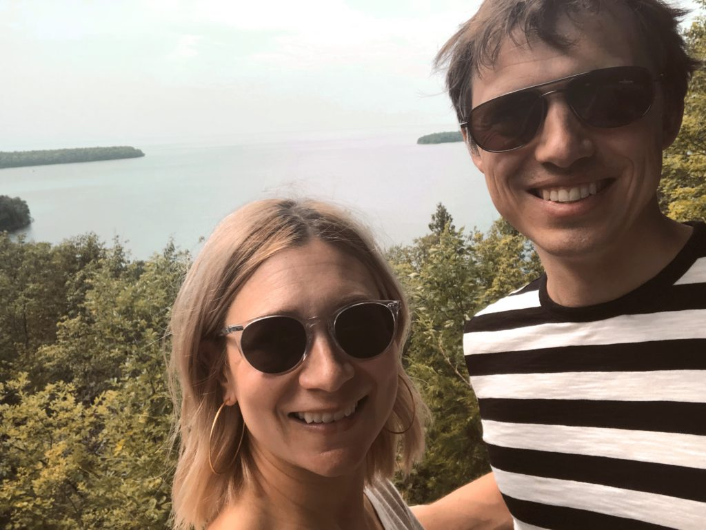 taking a selfie in peninsula state park, clear frame glasses from glasses USA, prescription sunglasses, everlane men's tee, black and white striped tee