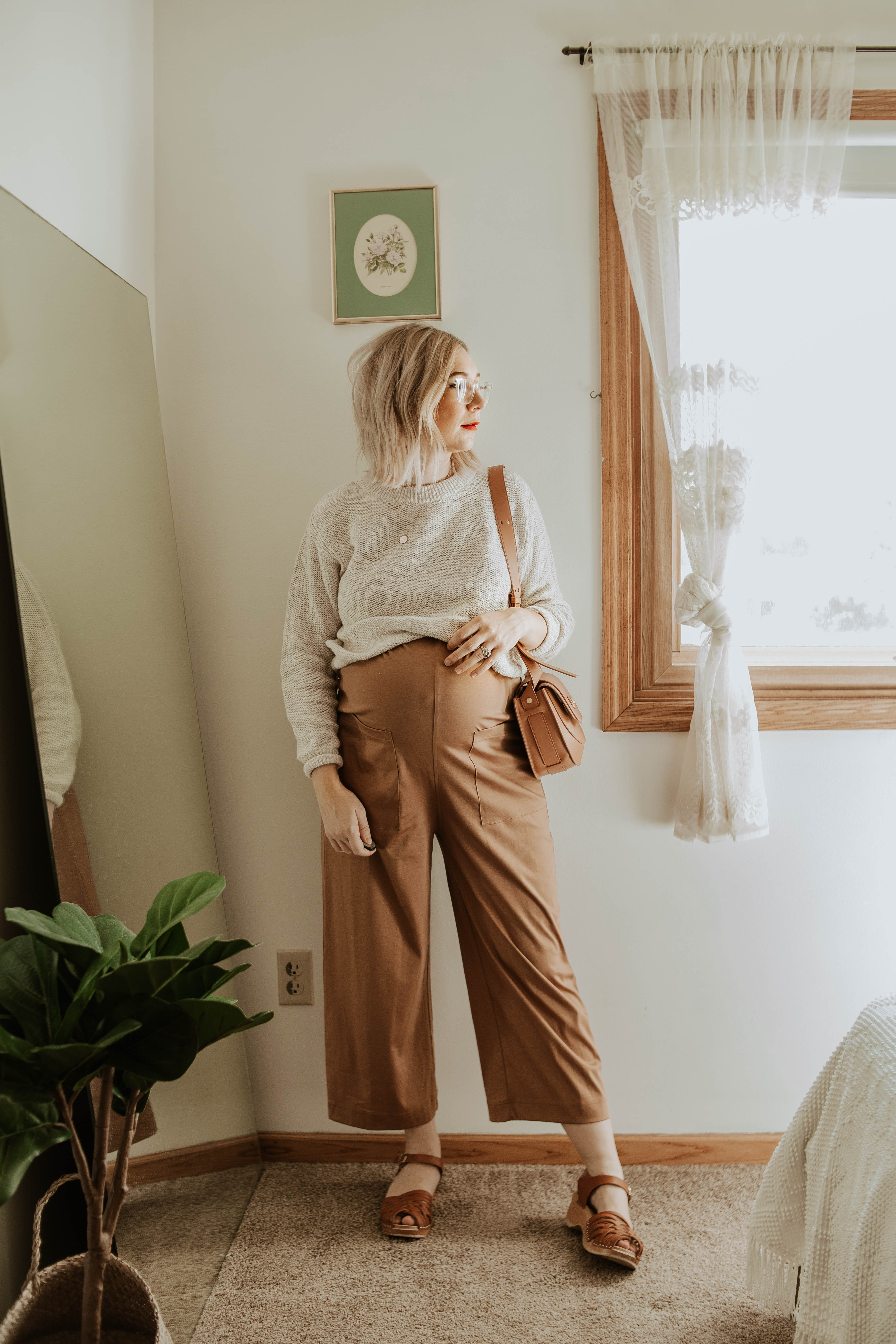 Transitional Summer to Fall Outfitseverlane cotton jumpsuit toasted almond, everlane cotton sweater, friday by jwpei brown saddle bag, troentorp clogs, ann clogs