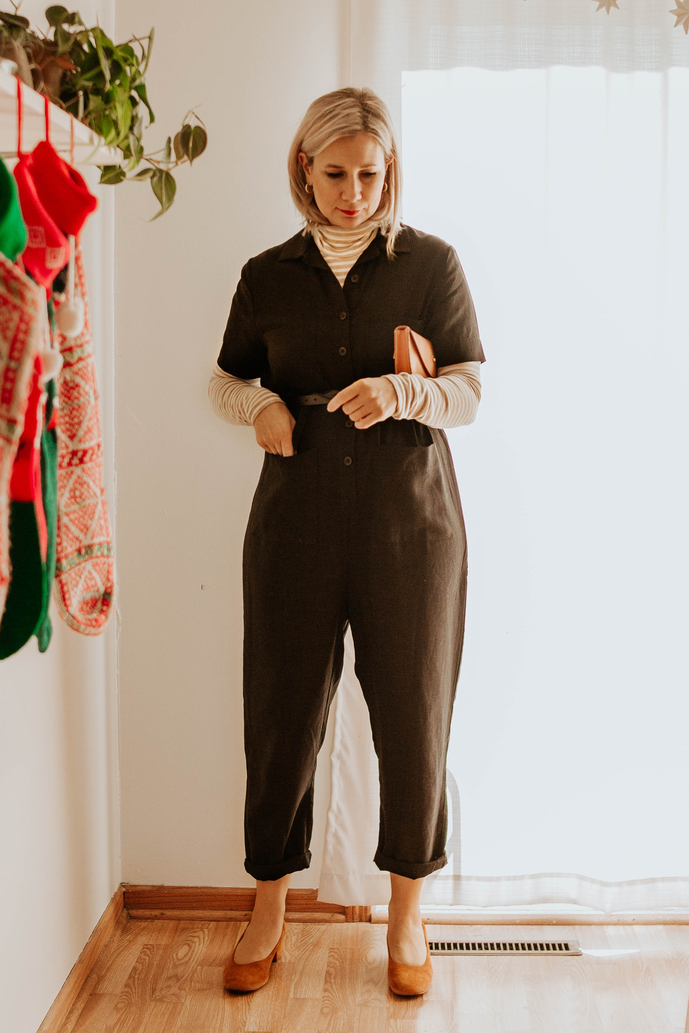 Mini Holiday Lookbook Featuring Ethical Fashion, tradlands jumpsuit, black short sleeve jumpsuit, everlane day heels, striped turtleneck, turtleneck under jumpsuit, tree fairfax bum bag, belt bag