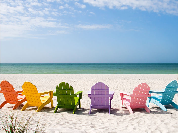 summer retreat - colorful chairs on the beach