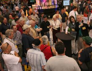 Magician capturing crowds at Mesto Mineral trade show booth