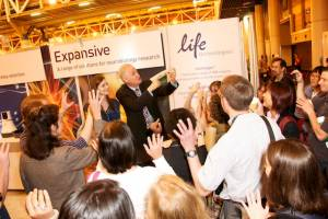 Magician Danny Orleans presenting at Science trade show