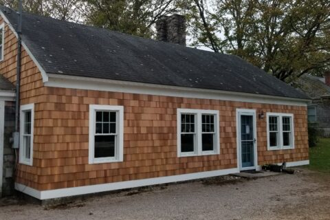 Cedar Wood Shake Siding & Impact Resistant Windows.